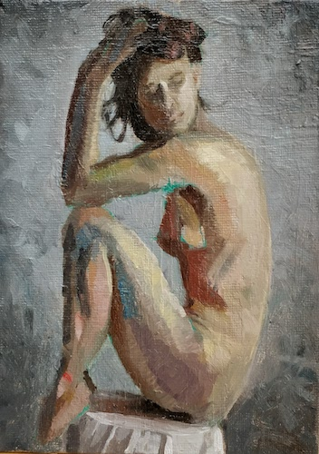 Female Figure Seated on a Table